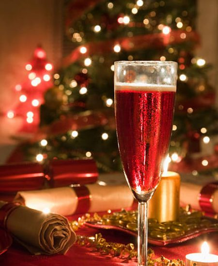 Glass of Rose Champagne on a decorated Christmas day dinner table